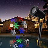 Beweglicher weißer oder farbiger Schneeflocken Weihnachtsfeiertag des Autos beleuchtet...