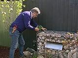 Ein Garten mit Außenküche für Nathan